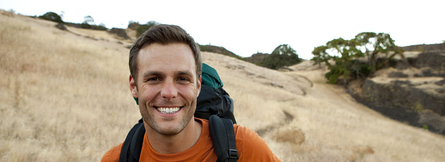 Smiling man hiking