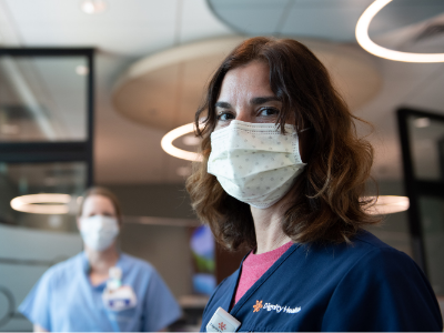Portrait of two female French Hospital nurses wearing masks standing in the Emergency Dept